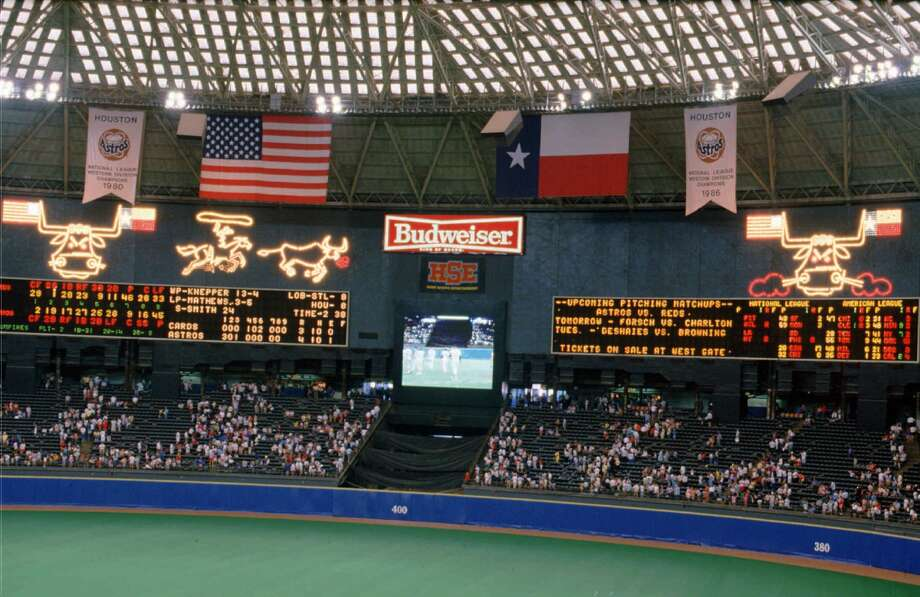 The Houston Astrodome scoreboard spectaculer erupts with snorting bulls and calf-roping cowboys after the Astros beat the St. Louis Cardinals in 1988. The scoreboard was dismantled in September of 1988 to make room for 10,000 more seats in the facility. (AP Photo/Tim Johnson) Photo: TIM JOHNSON/AP