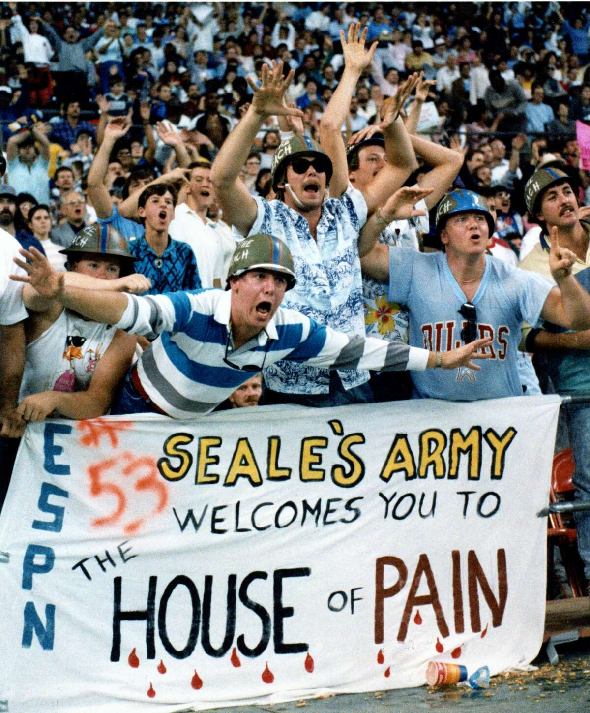 Members of Seale's Army, named for Oiler linebacker Eugene Seale, harass the Pittsburgh Steelers during their game in the Astrodome Sunday December 4, 1988. Leading the jeers are, from left, Mark Provost, Greg Wollin and Greg Beard. Unfortunately for them, the Oilers lost 37-34.