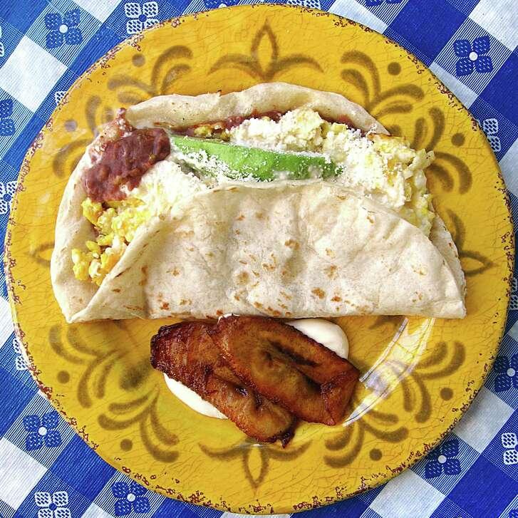 Baleada compuesta with beans, crema, queso duro, eggs and avocado on a handmade flour tortilla from Sabor Latino.