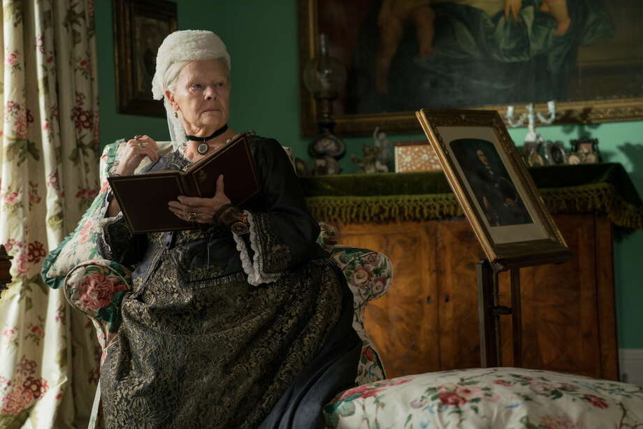 "In this image released by Focus Features, Judi Dench appears in a scene from ""Victoria and Abdul."" Dench was nominated for a Golden Globe for best actress in a motion picture comedy or musical for her role in the film. The 75th Golden Globe Awards will be held on Sunday, Jan. 7, 2018 on NBC.(Peter Mountain/Focus Features via AP) ORG XMIT: NYET133 Photo: Peter Mountain / © 2017 Focus Features LLC. All Rights Reserved."