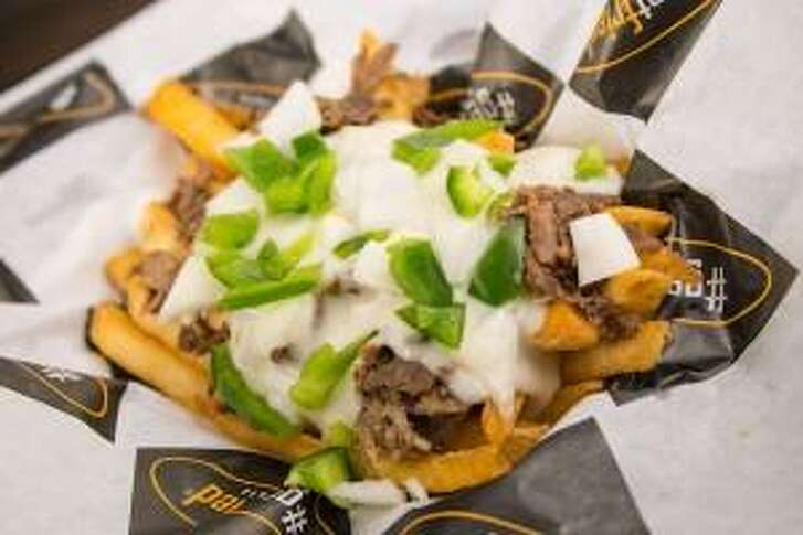 The Rocky Balboa fries at #getfried are topped with sliced sirloin, sauteed onion, sweet peppers and melted cheese.