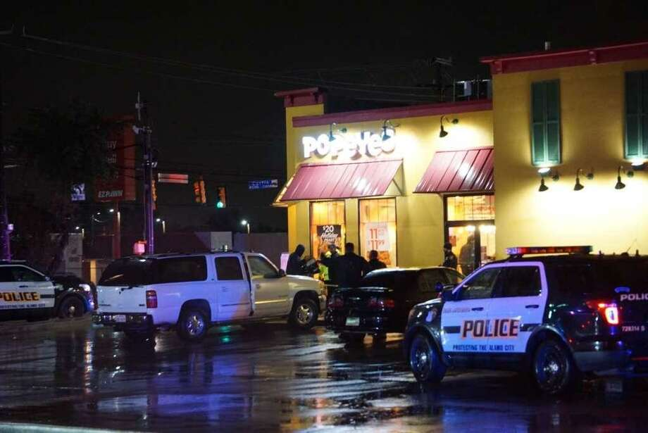 Police outside the restaurant on South East Military Drive where a robber was fatally shot by a customer Wednesday. Police said the same robber had fled a Dollar General store on Nov. 21 after a customer there shot at him and missed, and detectives believe they can connect him to several other robberies. Staff photo by Jacob Beltran. Photo: /Staff