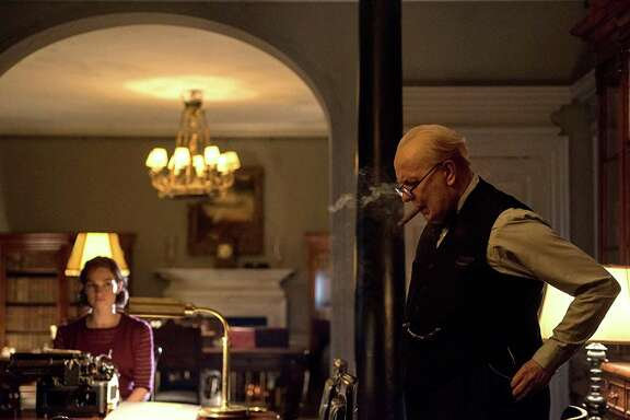"An unrecognizable Gary Oldman stars as Winston Churchill in ""Darkest Hour."""