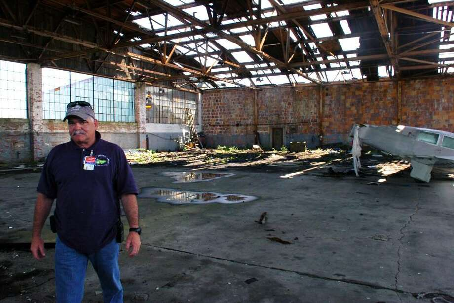 Steve Ford, Superintendent of Operations at Sikorsky Memorial Airport, in Stratford, Conn. walks thourgh the airport's old hanger building, June 29th, 2010. The vaccant structure received more damage during last Thursday's storm. Photo: Ned Gerard / Connecticut Post