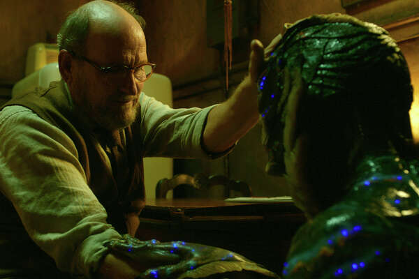 """This image released by Fox Searchlight Pictures shows Richard Jenkins, left, and Doug Jones in a scene from the film """"The Shape of Water."""" On Monday, Dec. 11, 2017, Jenkins was nominated for a Golden Globe for best supporting actor in a motion picture for his role in the film. The 75th Golden Globe Awards will be held on Sunday, Jan. 7, 2018 on NBC.  (Fox Searchlight Pictures via AP)"""