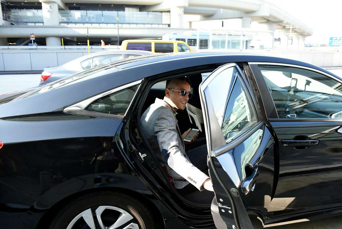 David Yanni, arriving from Los Angeles, climbs into the back of a Lyft car picking him up at San Francisco International Airport in San Francisco, Calif., on Wednesday December 13, 2017.