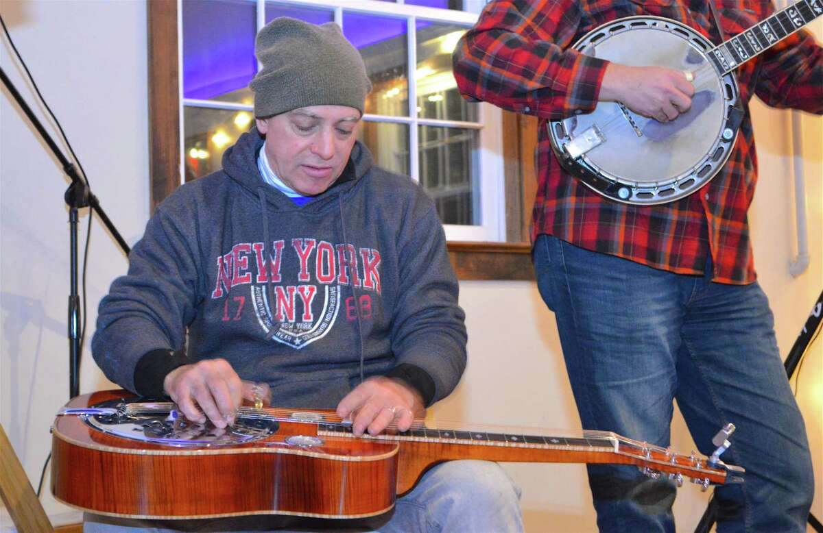 Brien Brannigan of New York City solos on the Dobro guitar at the Westport Country Playhouse's