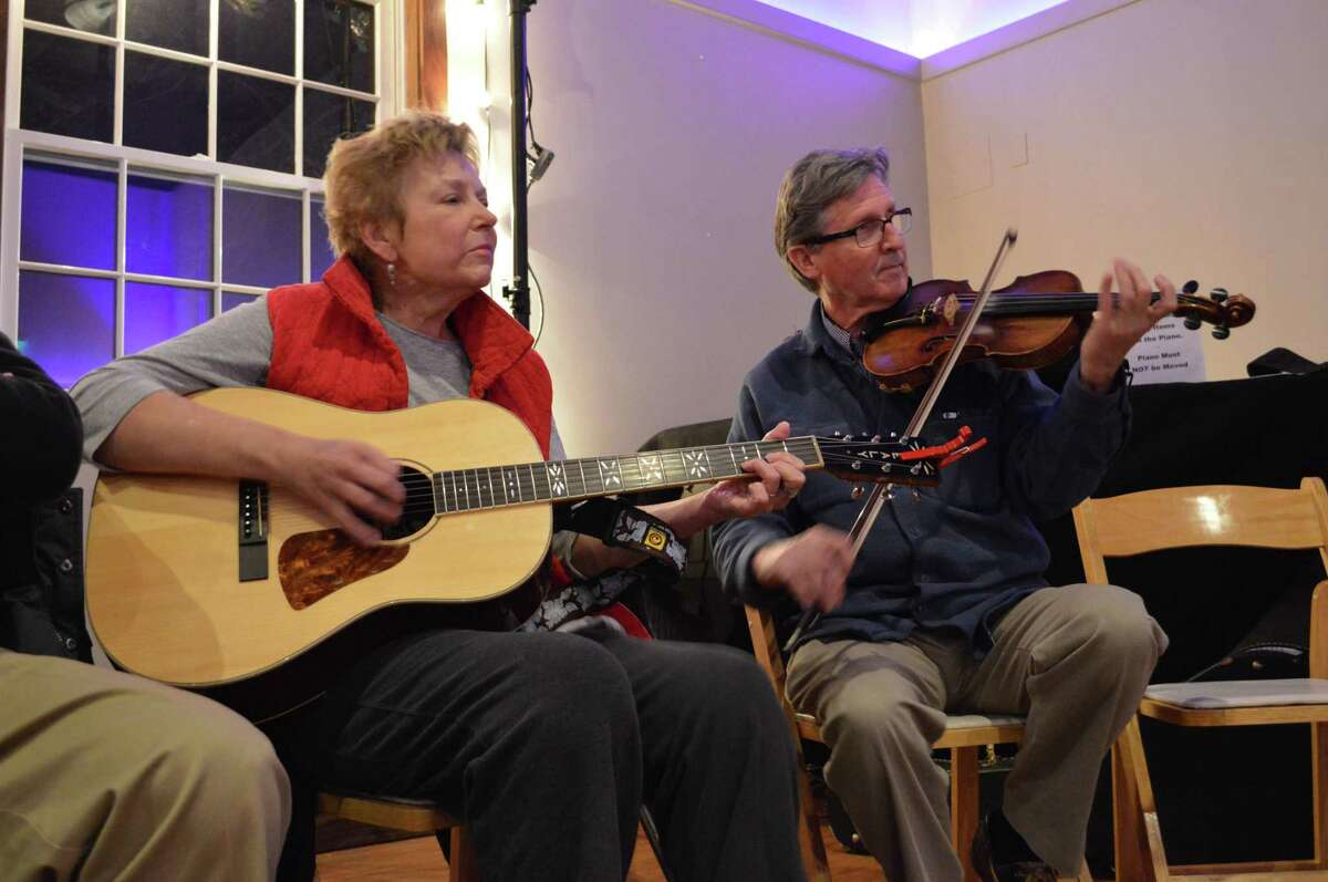 Myra and Colin Healy of Stratford play along at the Westport Country Playhouse's