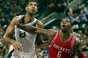 San Antonio Spurs' Tim Duncan and Houston Rockets' Terrence Jones struggle for position on a free throw during second half action Friday Oct. 23, 2015 at the AT&T Center. The Spurs won 111-86.