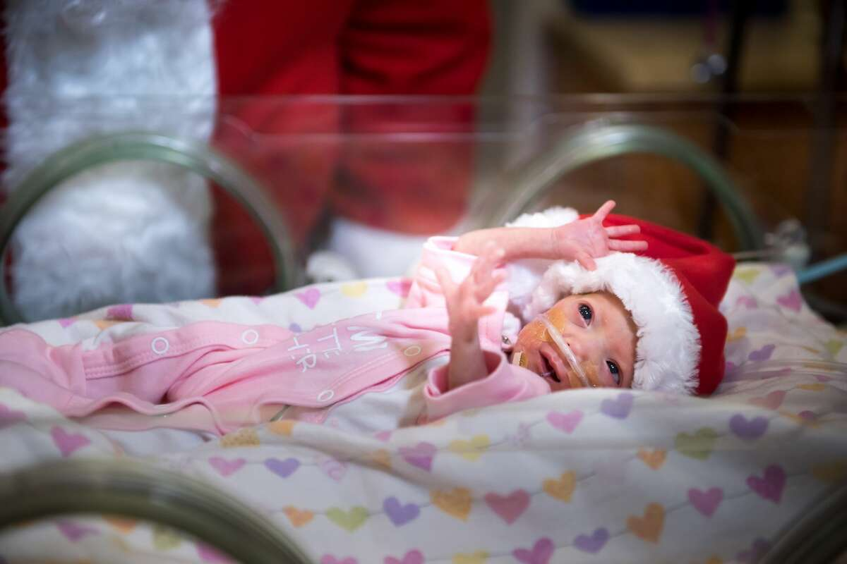 Santa Claus recently paid a visit to Texas Children's Hospital in Houston to help comfort families with babies in theNeonatal Intensive Care Unit (NICU).