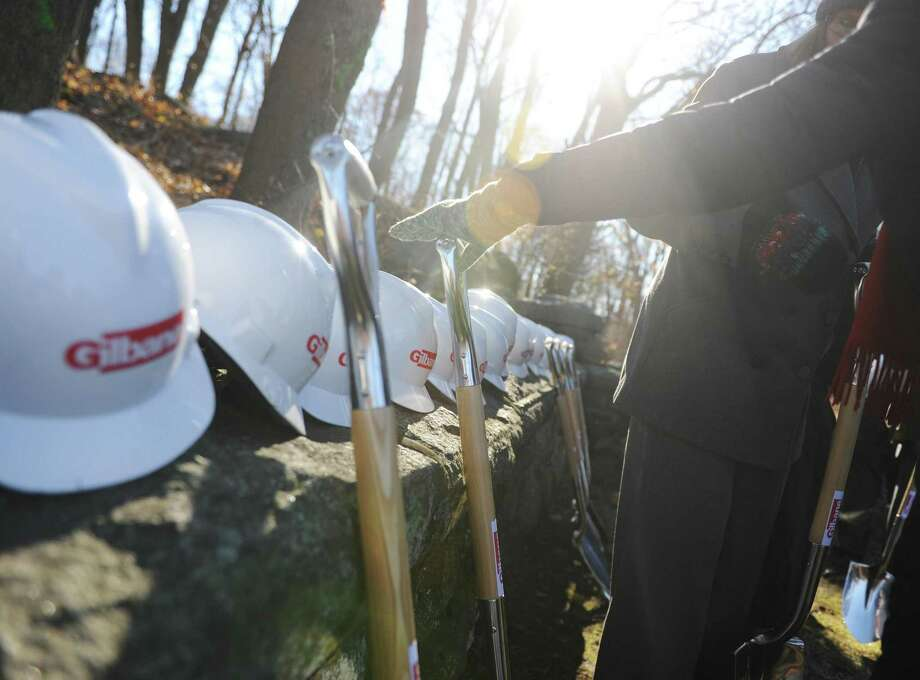 Folks grab shovels and hardhats for the groundbreaking ceremony for the new New Lebanon School in the Byram section of Greenwich, Conn. Thursday, Dec. 7, 2017. State and town officials, Board of Education members, building committee members, school administrators, staff and students attended the ceremony. Construction workers will start clearing and leveling the site over the coming weeks and will begin construction shortly afterwards. Photo: Tyler Sizemore / Hearst Connecticut Media / Greenwich Time