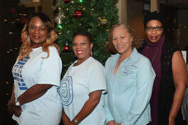 From left, Teri Guillory, Lisa Mayfield, Tressie Holmes and Jeanni Sutton donated $100 to the Empty Stocking Fund at the Beaumont Enterprise on Wednesday. The women raised the money through the Zeta Amicae of Beaumont group.  Photo taken Wednesday, December 13, 2017 Guiseppe Barranco/The Enterprise