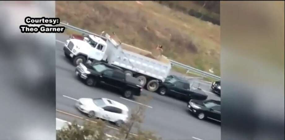 A man ran into traffic and hopped on a truck while naked during rush hour Tuesday, Dec. 12, near Dulles, Virginia. Photo: Screenshots Fox5DC