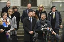 Ian Hockley, father of Dylan Hockley, one of the children killed in the 2012 Sandy Hook shooting, addresses the media after a hearing before the state Supreme Court in Hartford, Conn., Tuesday, Nov. 14, 2017.