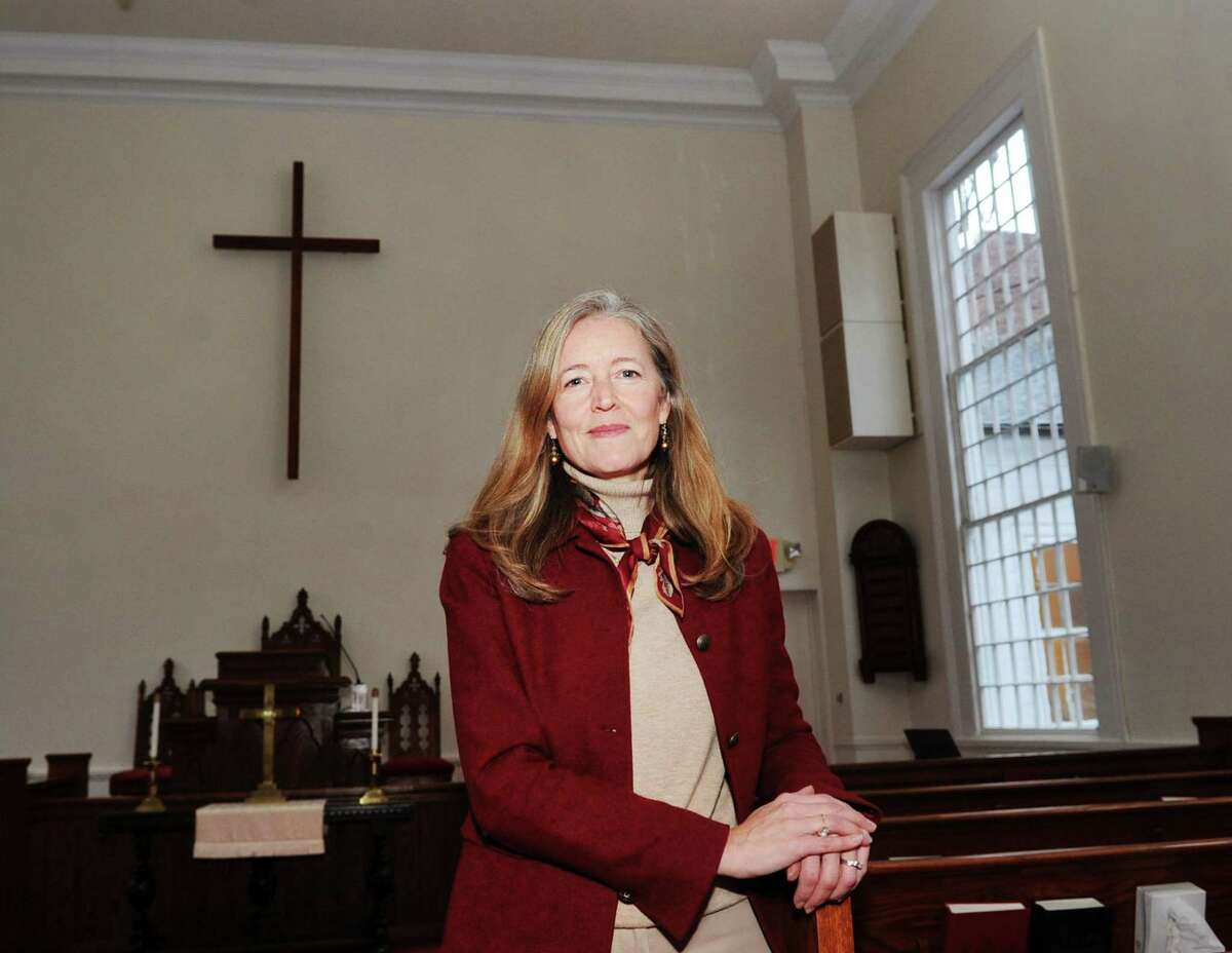 """Heather Wright, director of the Center for Hope and Renewal in the sanctuary at the center located at 237 Taconic Road in Greenwich, Conn., Tuesday, Dec. 12, 2017. The Center for Hope and Renewall, that calls itself a """"faith-friendly professional counseling and resource center,"""" has been operating out of the Stanwich Congregational Church since Sept. 2007 without formal approval from the Planning and Zoning Commission. Neighbors are upset that the center is operating a business, bringing potentially dangerous mentally unstable people into their residential neighborhood. The Stanwich Church is now requesting P&Z approval for the center."""