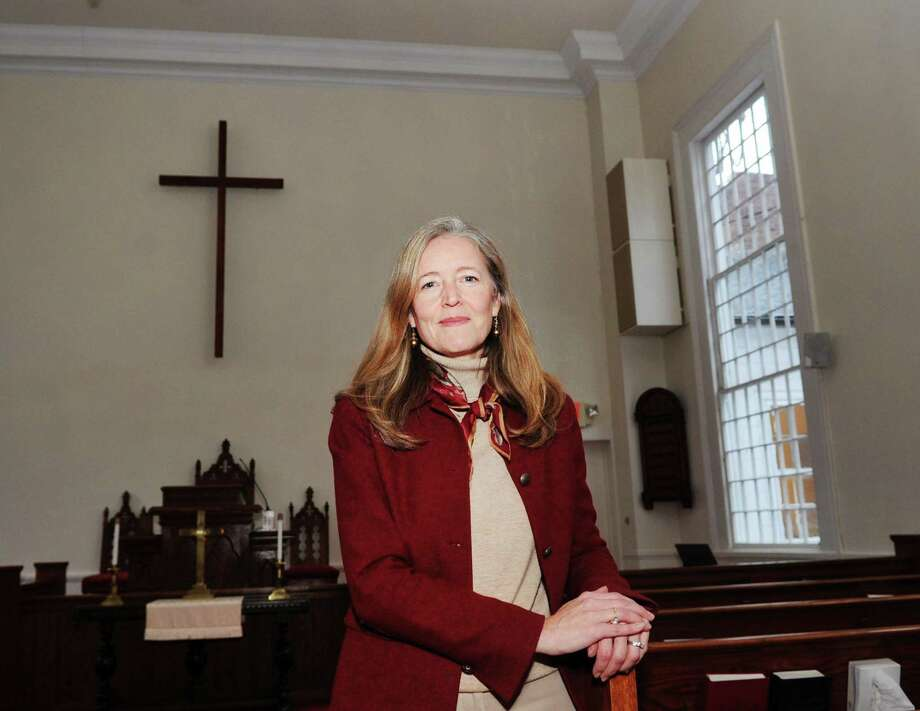 "Heather Wright, director of the Center for Hope and Renewal in the sanctuary at the center located at 237 Taconic Road in Greenwich, Conn., Tuesday, Dec. 12, 2017. The Center for Hope and Renewall, that calls itself a ""faith-friendly professional counseling and resource center,""  has been operating out of the Stanwich Congregational Church since Sept. 2007 without formal approval from the Planning and Zoning Commission. Neighbors are upset that the center is operating a business, bringing potentially dangerous mentally unstable people into their residential neighborhood. The Stanwich Church is now requesting P&Z approval for the center. Photo: Bob Luckey Jr. / Hearst Connecticut Media / Greenwich Time"