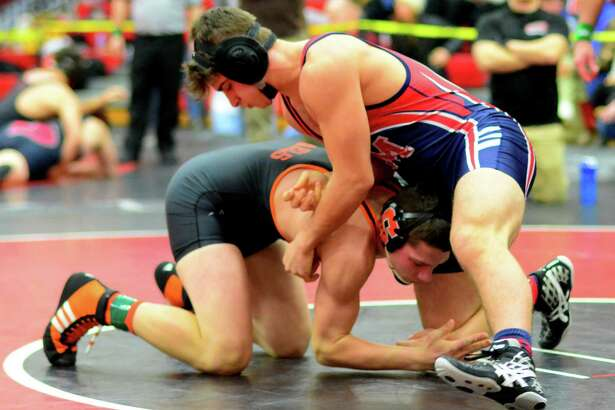 Shelton's Colin Scanlon, bottom, grabs Brien McMahon's Nick Marsan during wrestling tournament action in Fairfield, Conn. on Saturday Jan. 7, 2017.