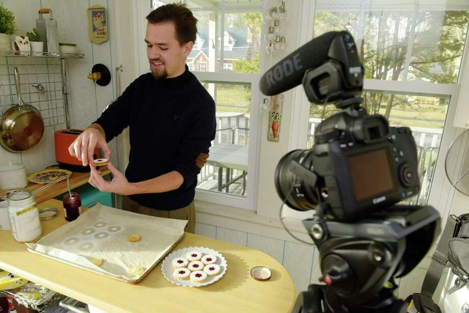 Cooper Nelson creates cookies in his kitchen on Wednesday, Dec. 6, 2017, in Delmar, N.Y.  Nelson is the creator of silentlycooking.com videos.  (Paul Buckowski / Times Union) Photo: PAUL BUCKOWSKI / 20042330A