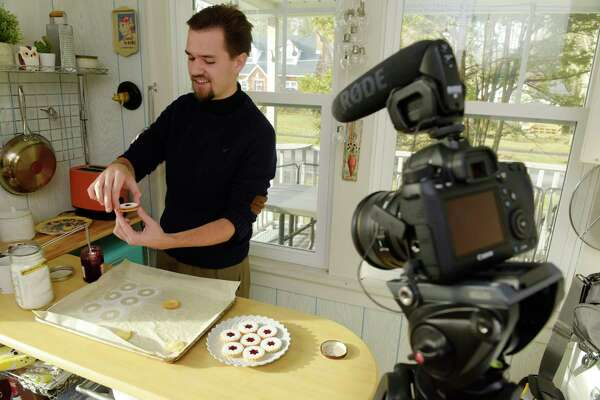 Cooper Nelson creates cookies in his kitchen on Wednesday, Dec. 6, 2017, in Delmar, N.Y.  Nelson is the creator of  silentlycooking.com  videos.  (Paul Buckowski / Times Union)