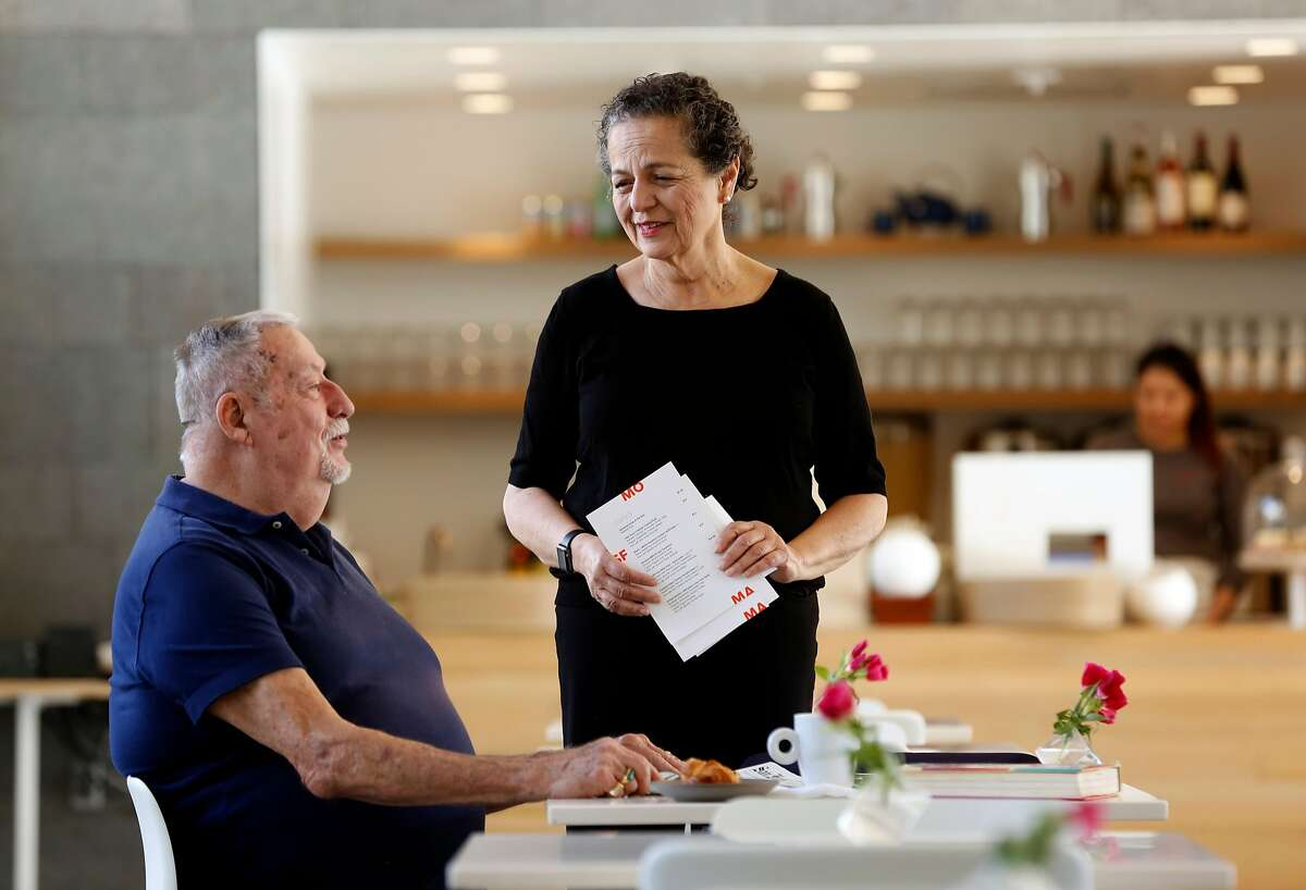 Regular customer Chuck Buntjer talks with Rosemarie McKeon who is the maitre d' at Cafe 5 at the San Francisco Museum of Modern Art in San Francisco, Calif., on Tuesday December 5, 2017.