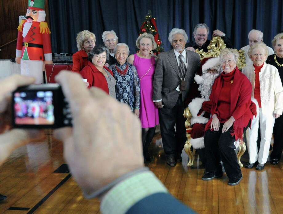 Helma Varga, 77, of Greenwich, sat in Santa's lap as a group photo was taken during the Greenwich Senior Center Holiday party at the Civic Center in Old Greenwich, Conn., Friday afternoon, Dec. 16, 2016. Photo: Bob Luckey Jr. / Hearst Connecticut Media / Greenwich Time