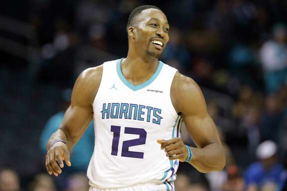 Charlotte Hornets' Dwight Howard (12) reacts to a dunk against the Orlando Magic during the second half of an NBA basketball game in Charlotte, N.C., Monday, Dec. 4, 2017. (AP Photo/Chuck Burton)