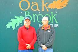 Oak Brook Golf Club superintendent Fred Ehlke, left, poses with owner Larry Suhre. Ehlke retired on Wednesday after 40 years on the job.