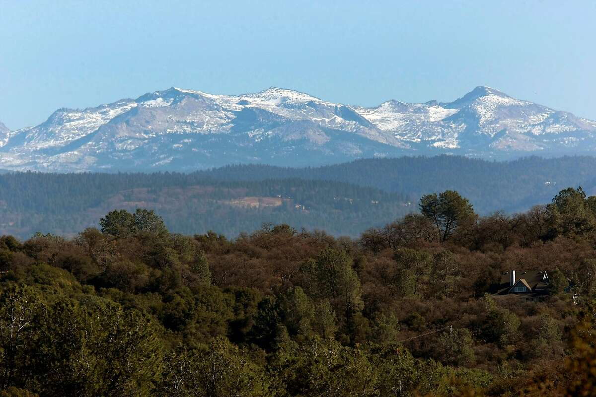 The Western Sierra's are seen in the distance with only a light dusting of snow which translates into less water for areas downstream when it melts in the spring, in Coloma, CA, Friday, January 17, 2014.