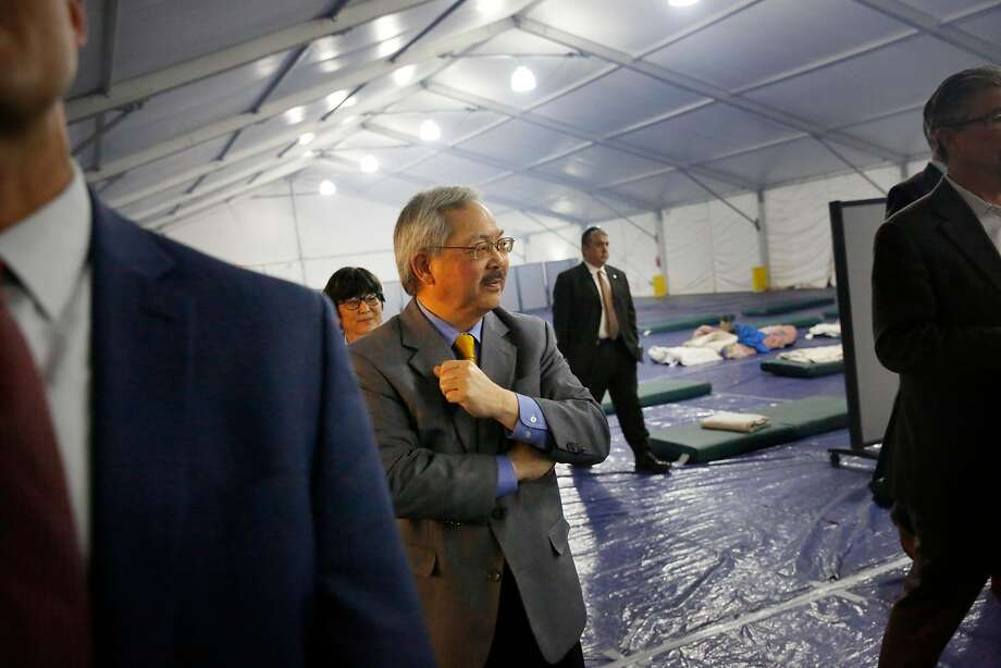 Mayor Ed Lee tours a Navigation Center for homeless people at Pier 80 in San Francisco. Navigation Centers, offering support and counseling and aimed at moving people into housing, are a much- admired innovation that Lee promoted. Photo: Lea Suzuki, The Chronicle