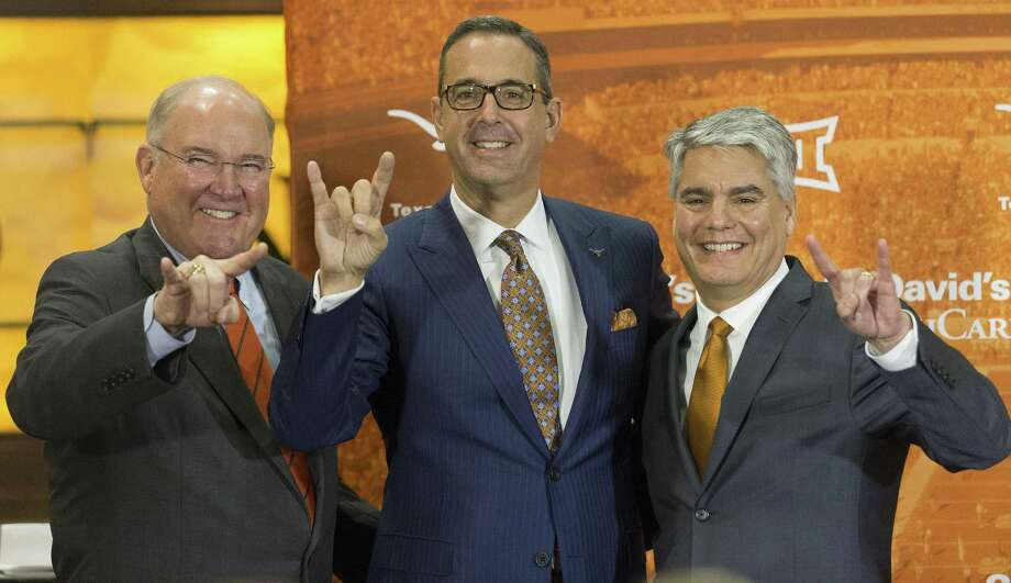 Interim Men's Athletics Director Mike Perrin, Chris Del Conte and Texas President Greg Fenves pose for photo as Del Conte is announced as the new vice president and athletics director at the University of Texas, Monday, Dec. 11, 2017. (Stephen Spillman / for American-Statesman) Photo: Stephen Spillman / Stephen Spillman / stephenspillman@me.com Stephen Spillman