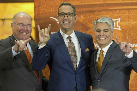 Interim Men's Athletics Director Mike Perrin, Chris Del Conte and Texas President Greg Fenves pose for photo as Del Conte is announced as the new vice president and athletics director at the University of Texas, Monday, Dec. 11, 2017. (Stephen Spillman / for American-Statesman)