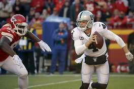 Kansas City Chiefs defensive lineman Chris Jones (95) pursues Oakland Raiders quarterback Derek Carr (4) during the second half of an NFL football game in Kansas City, Mo., Sunday, Dec. 10, 2017. (AP Photo/Charlie Riedel)