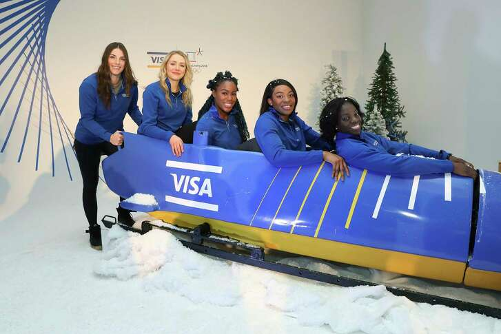 IMAGE DISTRIBUTED FOR VISA - Team Visa athletes and members of the Nigerian Women's Bobsled Team give Hilary Knight and Maggie Voisin a lesson on bobsledding at an Olympic Winter Games innovation and commerce event on December 7, 2017 in New York. (Amy Sussman/AP Images for Visa)