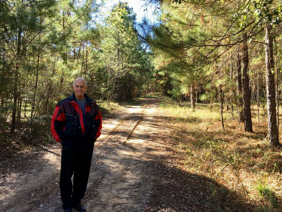Charlie Horton stands at the entrance to his property in Montgomery County In December, 2017. He opposes Conroe's plans to annex the area.