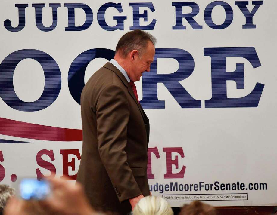 U.S. Senate candidate Roy Moore leaves the stage after giving a speech at the end of an election-night watch party at the RSA activity center, Tuesday, Dec. 12, 2017, in Montgomery, Ala. (AP Photo/Mike Stewart) Photo: Mike Stewart, STF / Copyright 2017 The Associated Press. All rights reserved.