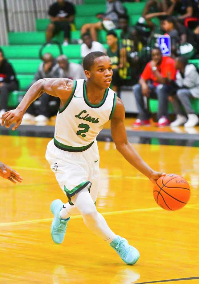 Spring guard Keionte Comelius scored 11 of his game-high 30 points in the fourth quarter and went 6-for-6 from the free-throw line in the final minute of a 63-59 win over Hightower in the championship game of the Eric Medina tournament. Photo: Tony Gaines/ HCN, Photographer