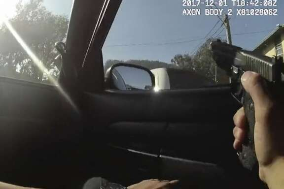In this Dec. 1, 2017 image taken from a San Francisco Police Department officer's body camera video, an officer aims his weapon before a fatal shooting in the Bayview neighborhood of San Francisco. San Francisco Police Chief Bill Scott released footage of the police shooting of an unarmed carjacking suspect in the city's Bayview neighborhood. The footage was released at a packed evening town hall meeting Thursday, Dec. 7 where Scott gave the community more information about the shooting. (San Francisco Police Department via AP)