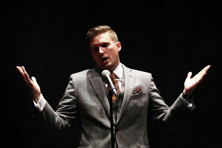 White nationalist Richard Spencer holds a news conference before giving a speech at the University of Florida in October.