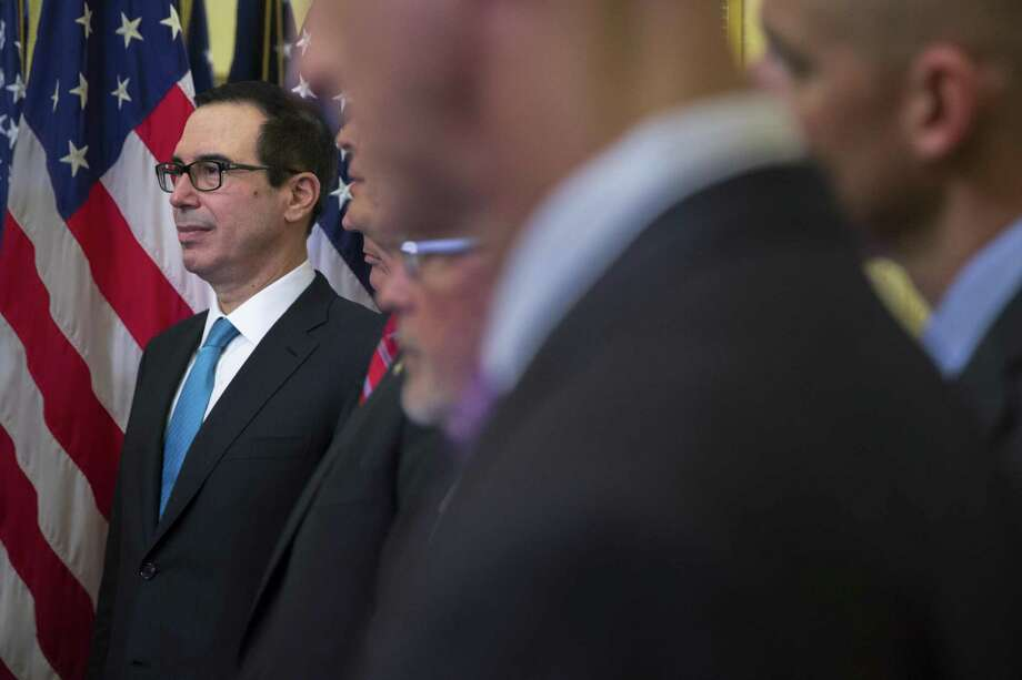 Treasury Secretary Steven Mnuchin looks on during a news conference about tax policy proposals, with Republican senators on Capitol Hill Nov. 7. In pitching the tax overhaul, Mnuchin has said repeatedly that the plan will pay for itself through a surge of economic growth. A one-page report released Monday proves no such thing. Photo: TOM BRENNER /NYT / NYTNS