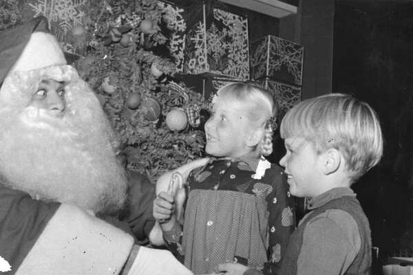 (l to r) Alida and Joey meet the World's Largest Santa at a preview of Miracle on 5th Street,  The Children's Benefit Christmas Party Photo ran 12/22/1974, p.1 (Sunday Datebook)