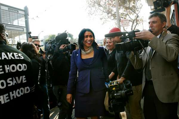 Acting Mayor London Breed makes her way through media grouped on the sidewalk along Howard Street waiting for her arrival at a gun buy-back press conference on Wednesday, December 13, 2017 in San Francisco, Calif.