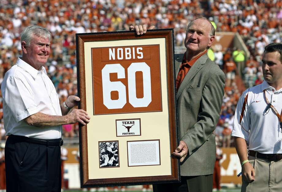 SPORTS Darrell Royal was on hand to help retire Tommy Nobis' number 60 Saturday in Austin. Texas versus Arkansas at Memorial Stadium in Austin Saturday, September 27, 2008. Tom Reel/Staff Photo: TOM REEL, STAFF / SAN ANTONIO EXPRESS-NEWS / treel@express-news.net