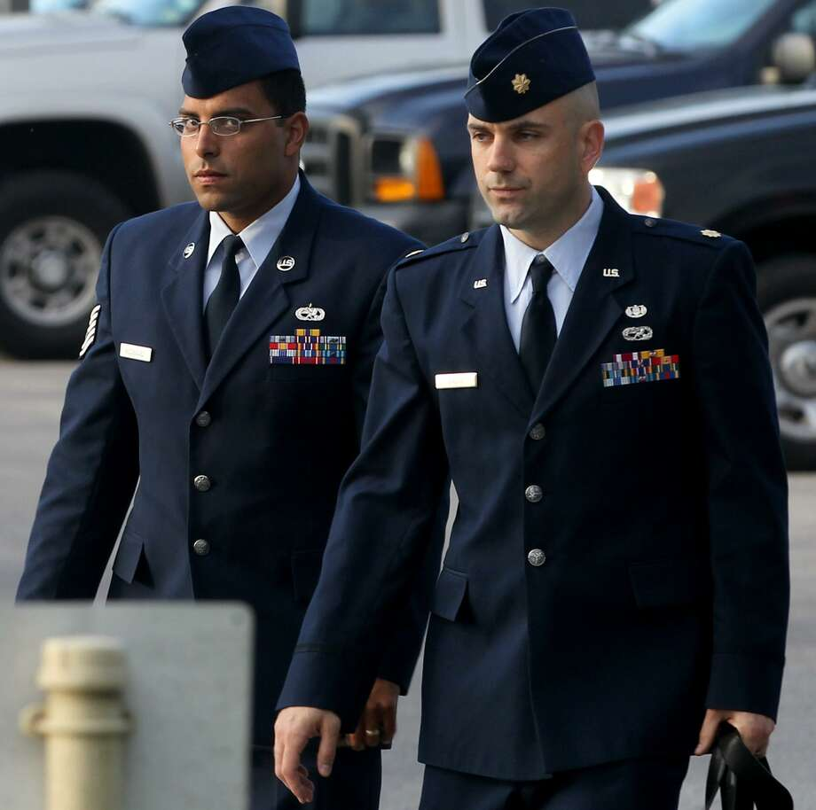 Air Force Tech Sergeant Jaime Rodriguez (left) heads for court Thursday June 6, 2013 at Joint Base San Antonio-Lackland. He is accused of having illicit contact with 18 women, and having sex with four of them. Photo: JOHN DAVENPORT, STAFF / SAN ANTONIO EXPRESS-NEWS / ©San Antonio Express-News