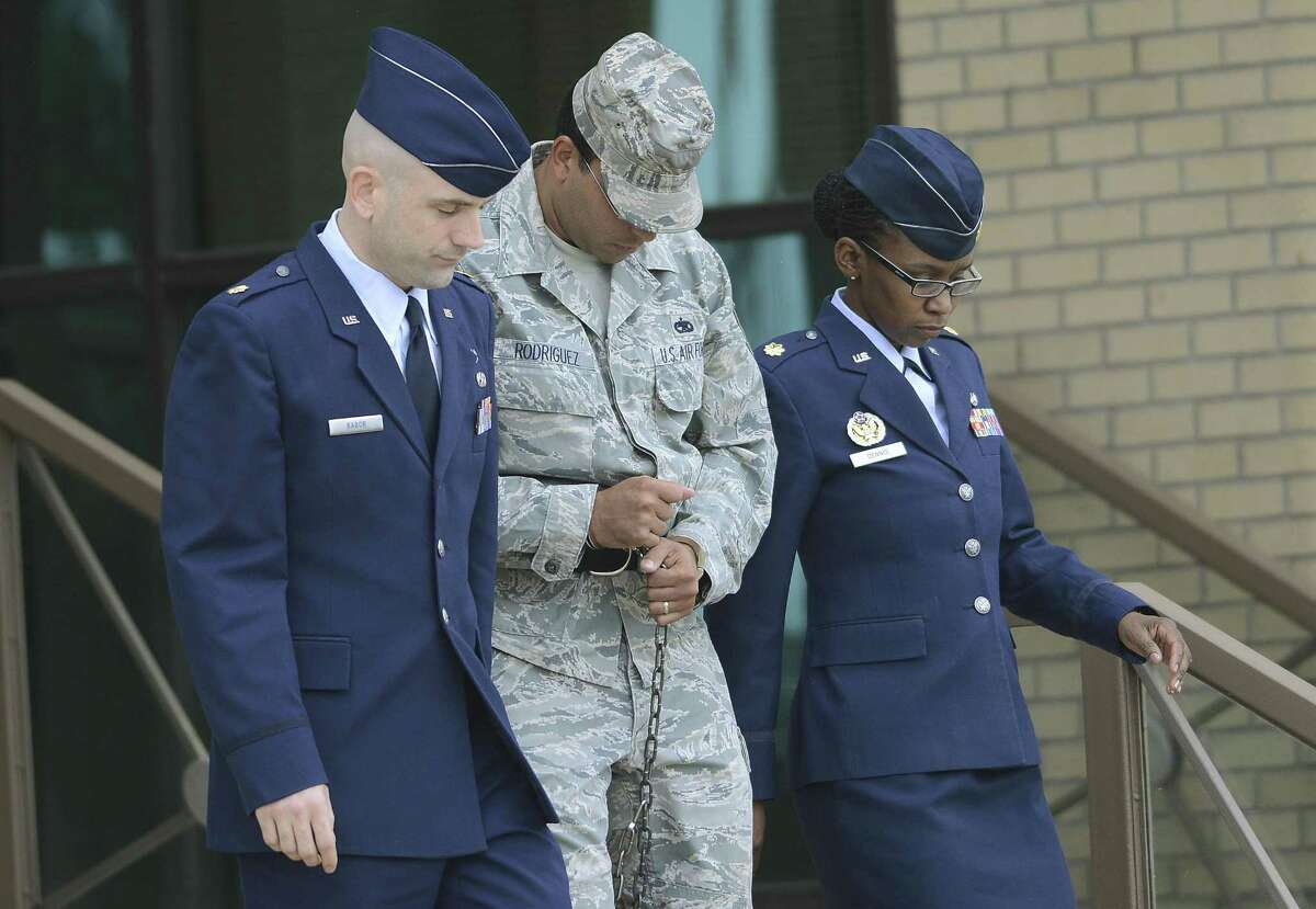 Air Force Tech Sergeant Jaime Rodriguez, middle, exits the court at Lackland Air Force Base where he was sentenced for sex crimes on Friday, June 14, 2013.