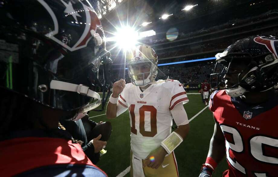 49ers quarterback Jimmy Garoppolo has led the 49ers to two victories — both on the road, including at Houston (above). Photo: David J. Phillip / Associated Press / Copyright 2017 The Associated Press. All rights reserved.