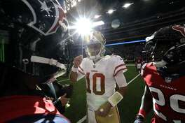 San Francisco 49ers quarterback Jimmy Garoppolo (10) talks with Houston Texans' Andre Hal (29) and Marcus Williams after an NFL football game Sunday, Dec. 10, 2017, in Houston. (AP Photo/David J. Phillip)