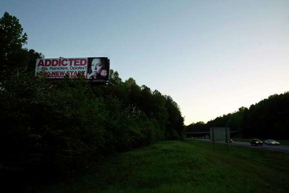 A billboard for a drug addiction service stands on the side of the road near Jasper, Ga. The harrowing truth is that major pharmaceutical companies have marketed highly addictive painkillers to doctors for more than a decade, downplaying the danger and triggering a national epidemic. (AP Photo/David Goldman)