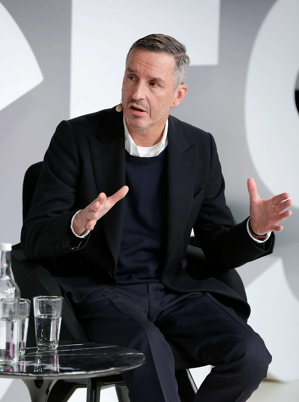 OXFORD, ENGLAND - NOVEMBER 30: Dries Van Noten speaks on stage during #BoFVOICES on November 30, 2017 in Oxford, England. (Photo by John Phillips/Getty Images for The Business of Fashion )