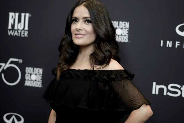 "FILE - In this Nov. 15, 2017 file photo, actress Salma Hayek attends the HFPA and InStyle Celebrate the 2018 Golden Globe Awards Season in West Hollywood, Calif. In an op-ed, Hayek says that her refusals of Harvey Weinstein's advances led to a nightmare experience making the 2002 Frida Kahlo biopic ""Frida."" The New York Times on Wednesday, Dec. 13, published Hayek's account in which she wrote that Weinstein was for years ""my monster."" She said that Weinstein would turn up at her door ""at all hours of the night, hotel after hotel, location after location."" (Photo by Richard Shotwell/Invision/AP, File)"