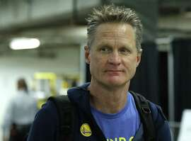 Golden State Warriors coach Steve Kerr arrives for the team's NBA basketball game against the Miami Heat, Sunday, Dec. 3, 2017, in Miami. (AP Photo/Joe Skipper)